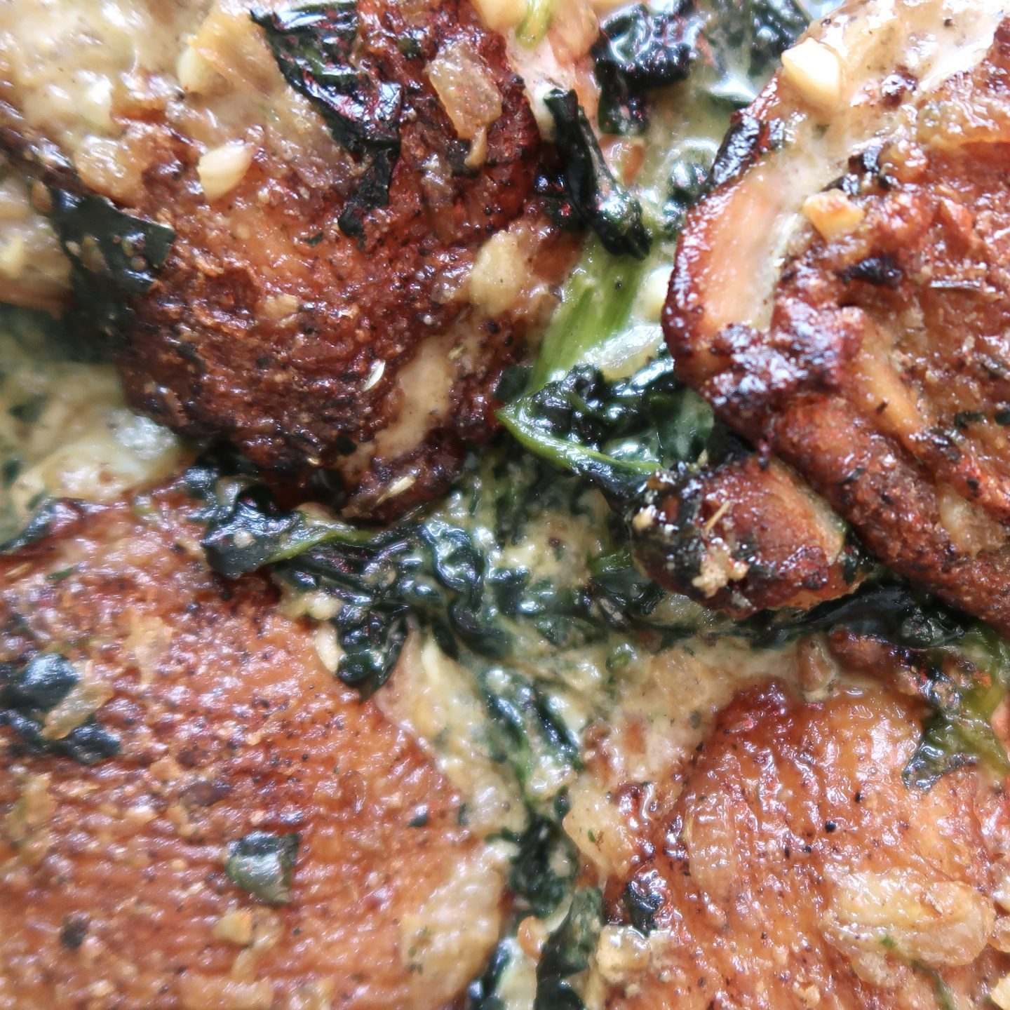 Oven-roasted chicken thighs in a garlic, spinach cream sauce