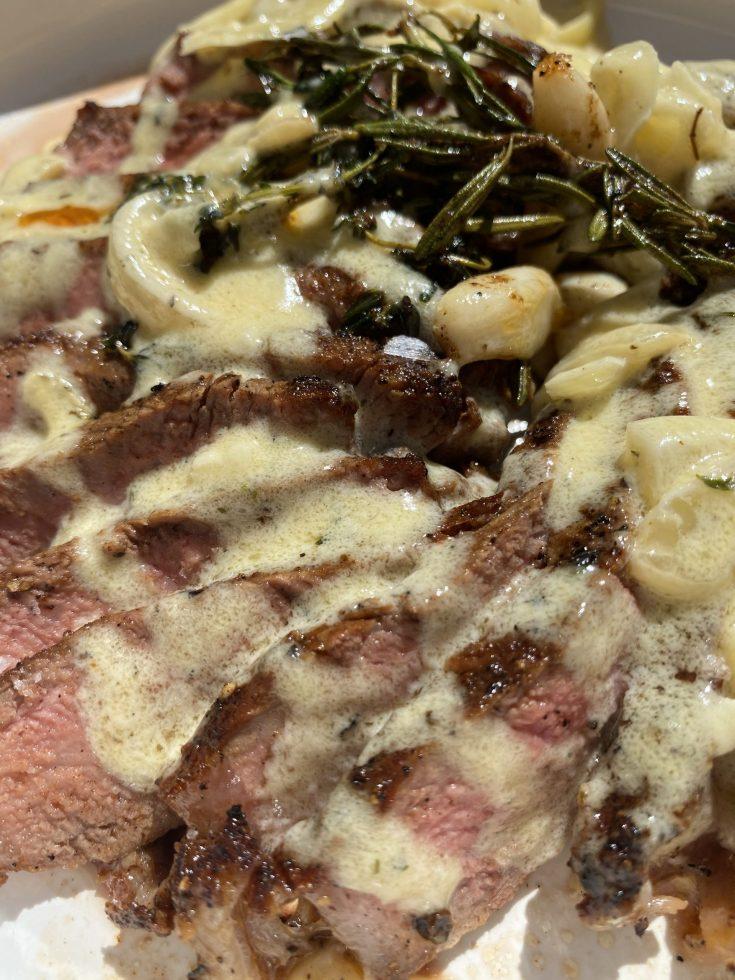 strip steak with garlic herb cheese sauce