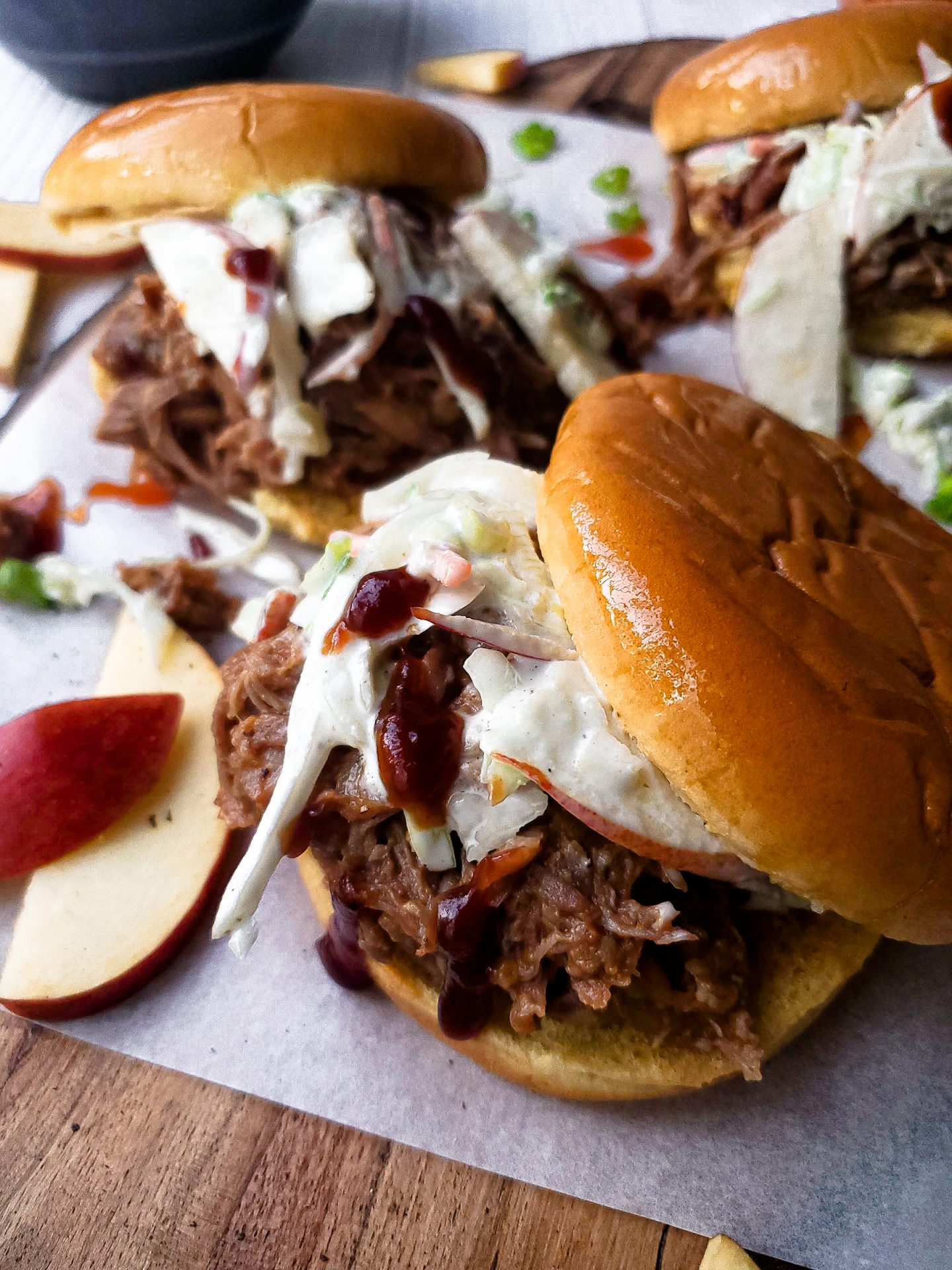 Apple Cider Braised Pulled Pork Sandwiches with Apple Slaw